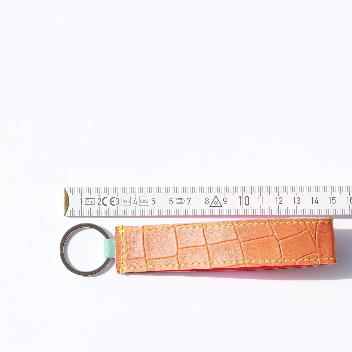 ausgefallene lederband schlüsselanhänger kroko mit neon pink